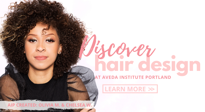 Discover Hair Design at the Aveda Institute Portland. Model with defined curls and black puff sleeves.